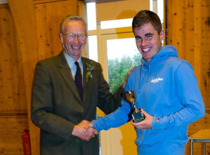 Calum MacLeod, Achnahaird receiving the trophy from 2013 Achiltibuie Gathering Chieftain, Bill Wilder.